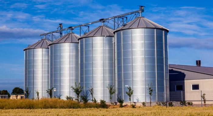 Four large grain silos
