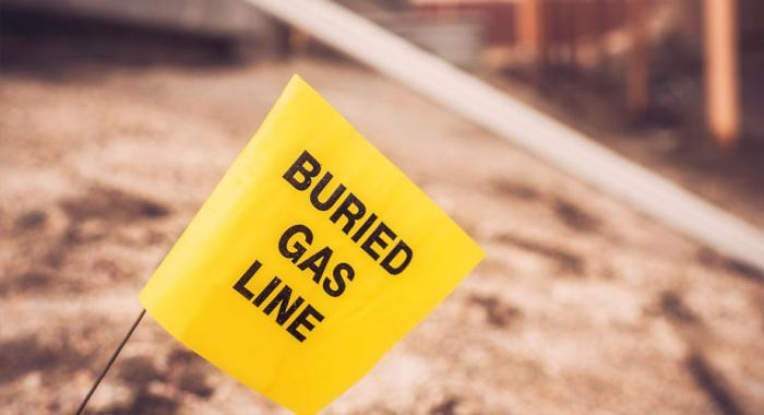 Yellow buried gas line flag in a construction site