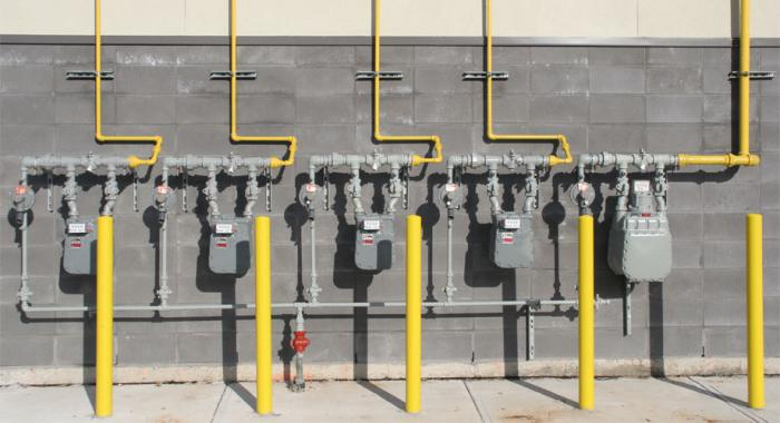 Row of gas meters outside a commercial building